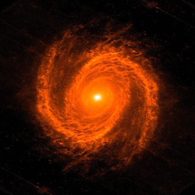 渦巻銀河の腕と中心ブラックホー...